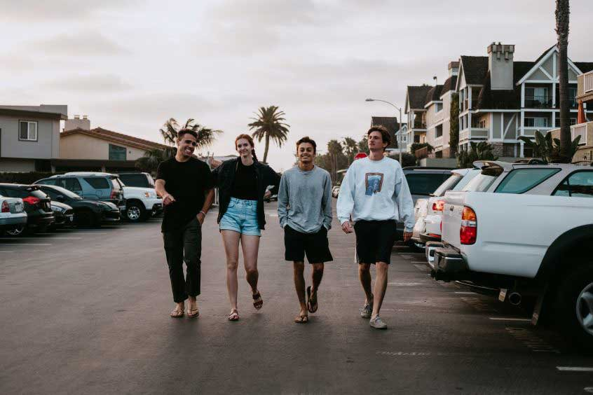young adults walking in parking lot - grant trevithick owner finance academy real estate