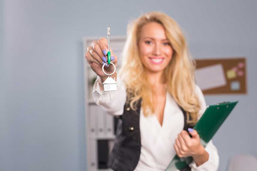 woman holding keys to home - professional real estate investor grant trevithick