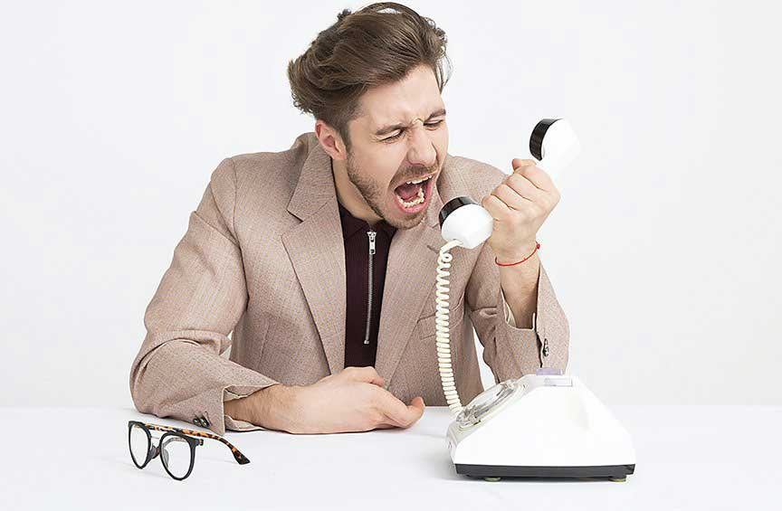 man yelling into phone - grant f trevithick owner finance seller finance passive income