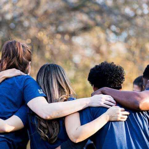 Volunteers hugging in a circle